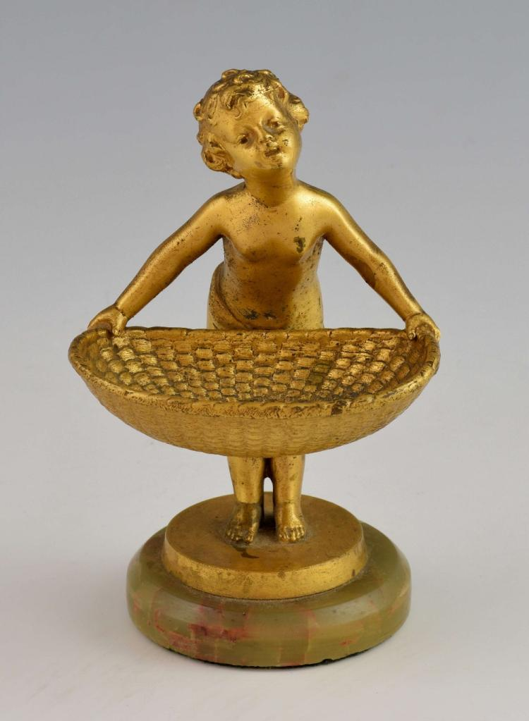 Gilt-metal figure of a putto carrying an open bas
