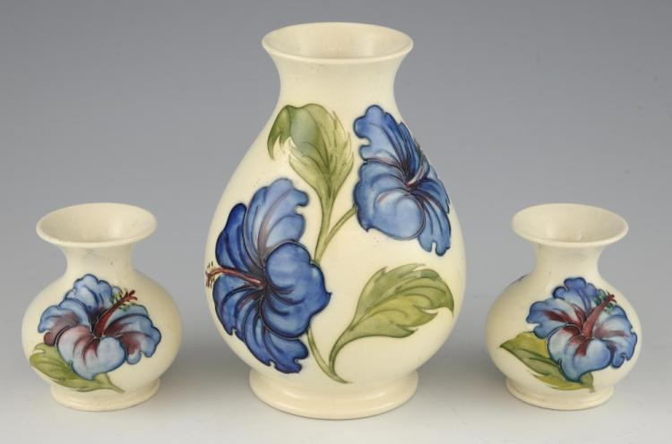 Three Moorcroft hibiscus pattern vases, with blue