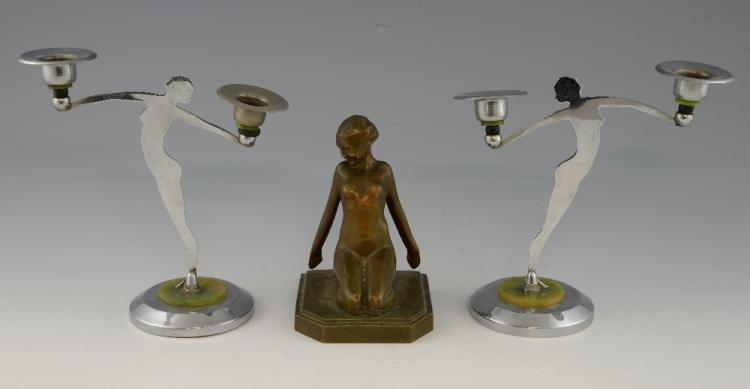A pair of Art Deco chrome figural candlesticks, 2