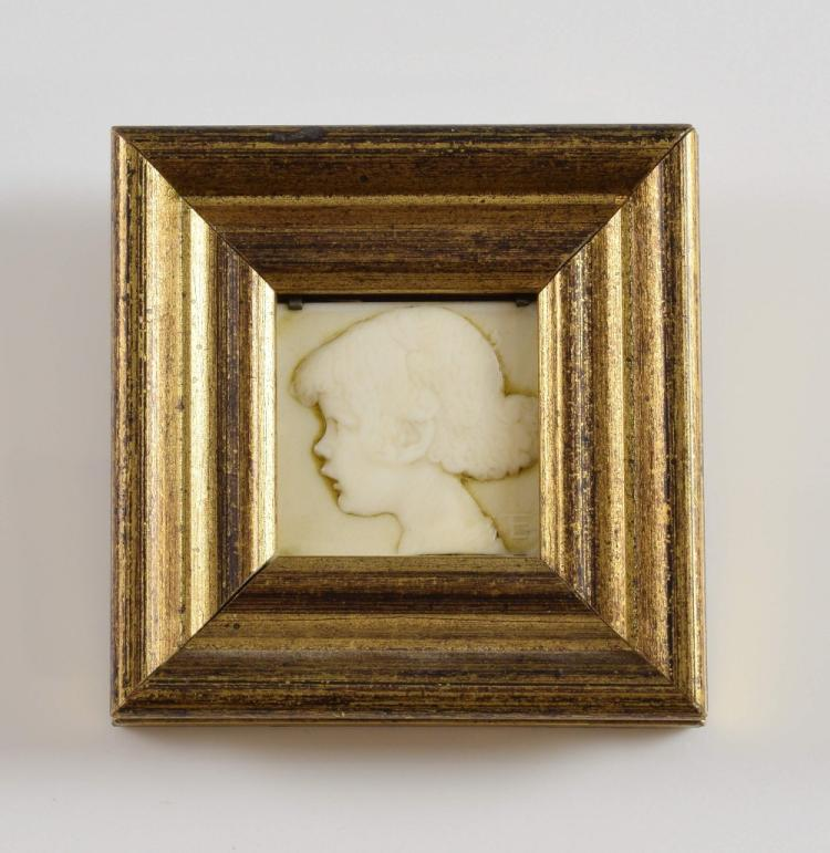 Early 20th century carved ivory plaque of a young