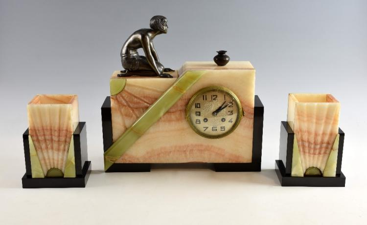 A French Art Deco onyx and marble sunburst clock &