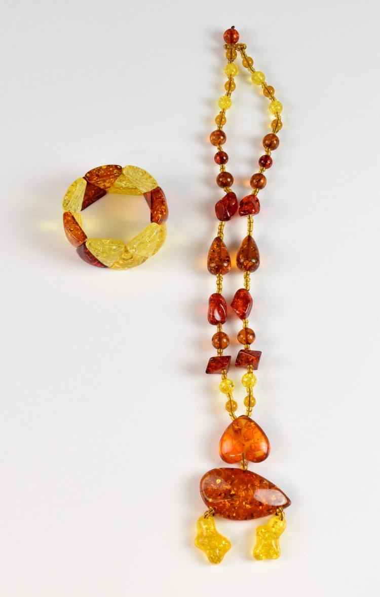 An amber pendant necklace, with inverted heart and