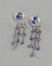 A pair of Sri Lankan sapphire earrings, oval cut with diamond surround, converted from studs to chandelier earrings