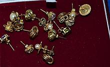 Nine pairs of 9ct gold stud earrings, including amethyst and peridot