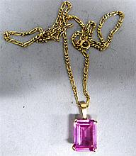 Pink stone and gold pendant