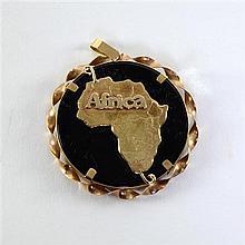 Gold and onyx Africa pendant
