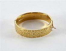Gold bangle with etched decoration of flowers, 9ct, 20 grams