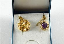 Gold pendant set with cultured pearls, on chain and an amethyst set pendant on chain