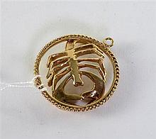 Gold birth sign pendant , scorpion within a circular rope border, 9ct, 20 gram