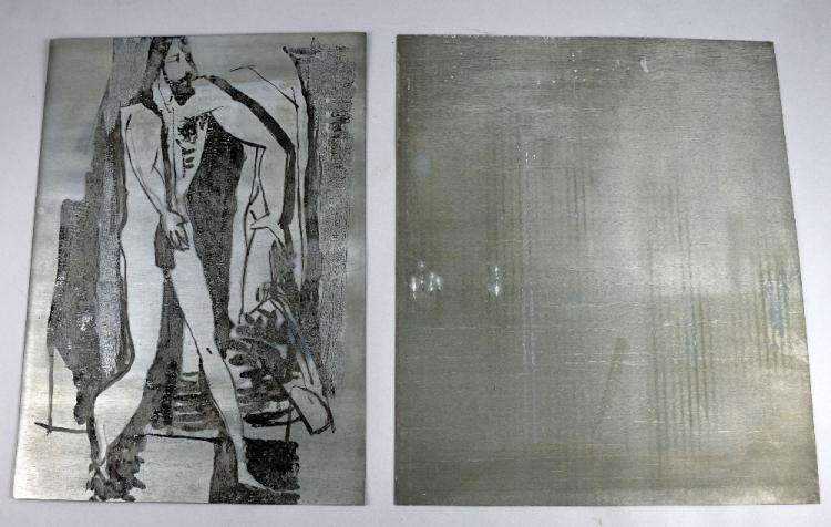 An engraved metal printing plate of a standing man