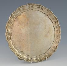 George V silver salver with serpentine border on t