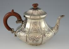 Victorian silver teapot with embossed decoration,