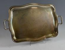 George V silver twin-handled tray of serpentine fo