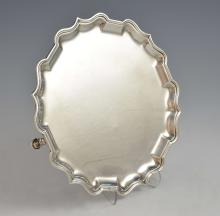 George V silver salver with shaped border on three