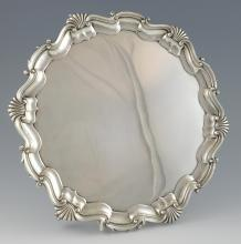 George V silver salver with moulded shell and scro