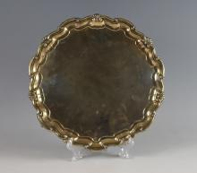 George V silver salver, on four scroll feet and wi