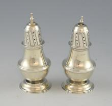 Pair of Edward VII silver pepperettes of baluster