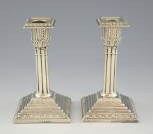 Pair of Victorian silver candlesticks with reeded