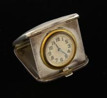 George V travelling clock in engine turned silver