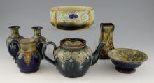 A group of Doulton stoneware, a pair of vases with