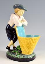 Minton majolica figure modelled as a boy leaning o