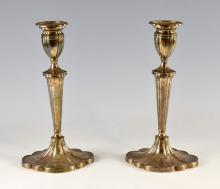 Pair of modern silver candlesticks with tapering columns and fluted lobed bases, by A. Taite & Sons Ltd., London, 1964, (filled bases), 31cm high,