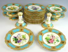 19th Century, possibly Minton, dessert service, the multiple borders in turquoise with six roundels, painted with butterflies and ducks highlighted in gilt, the centres decorated with flowers comprising 15 plates -  diameter  24 cm. Four low compost and two tall compost