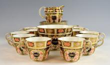 Crown Derby Imari pattern part tea service comprising cream jug, sugar bowl, eleven cups and eleven saucers, various date marks