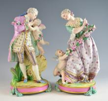 Pair of Dresden figures of a Man and a Woman with cherubs on round bases  - 36 cm