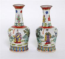 Pair of Chinese famile rose vases, decorated with flowers and figures in landscapes. 20th Century.