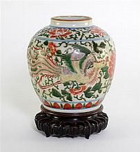 Chinese Wucai Ovoid vase decorated with phoenix between peony flower heads. 19th century