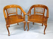 Indonesian indigenous wood round dining table and set of six similar tub chairs