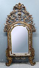 19th C carved giltwood mirror, the arched top with pierced surmount , carved leaf frame