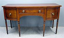 George III mahogany bowfronted sideboard with single drawer flanked by a deep drawer and a cupboard door on turned tapering legs