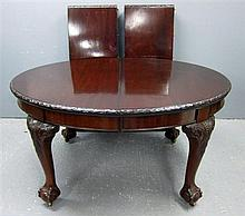 Early 20th Century Mahogany extending dining table on cabriole legs and ball and claw feet, with two extra leaves
