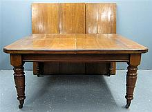 19th Century mahogany extending dining table with three extra leaves