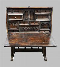 17th century Spanish walnut Vargueno with cast metal mounts, interior with various drawers on base with some later parts