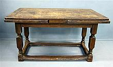 17th Century oak drawer leaf dining table on turned legs united by stretchers , some later parts