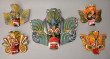 Five carved and painted masks and two ca