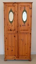 Modern pine wardrobe with two doors, on