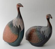 Two carved wood bird figures by The Feat