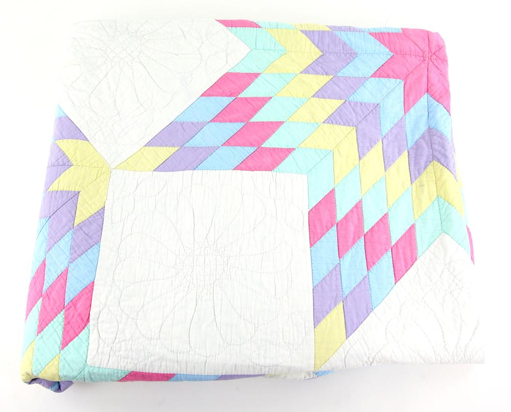 Cotton quilt with central star design surrounded b
