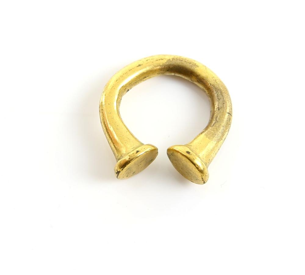 Gilt bronze penannular ring or fastener with trump