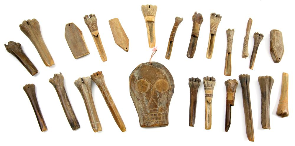 A collection of antique carved bone and horn artef