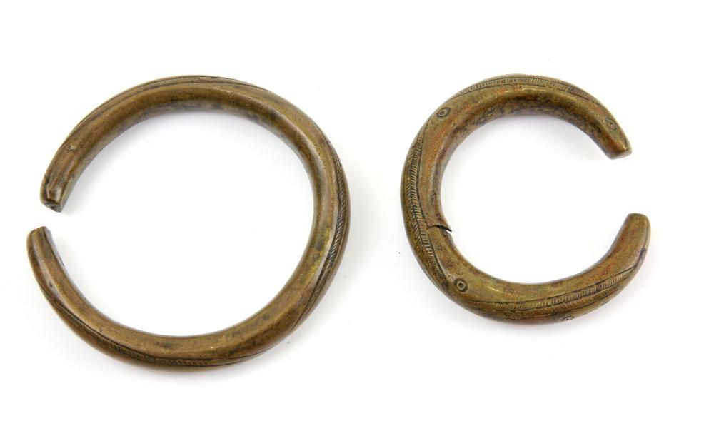 Two antique engraved bronze bracelets, in the form