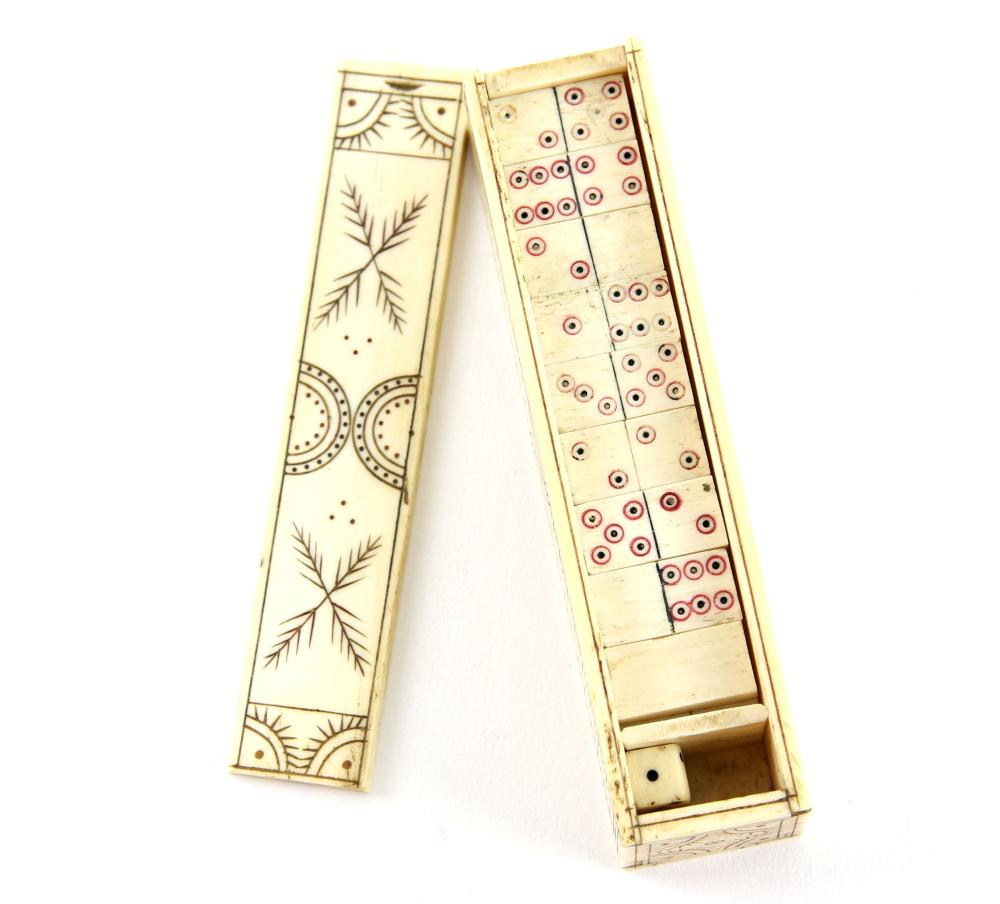 Miniature bone dominos set with a pair of dice in