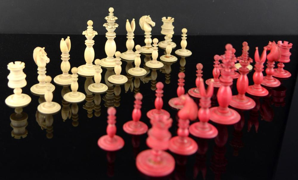 19th century red stained and white ivory chess set
