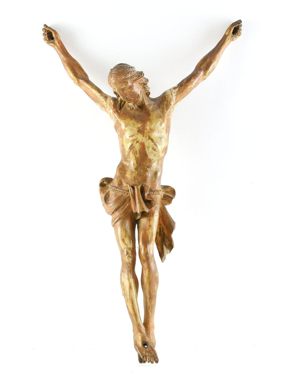 Carved wood figure of Christ crucified, about 61 c