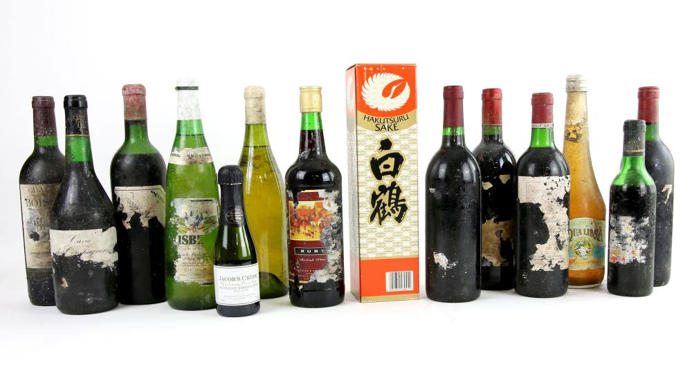 Fourteen various bottles of red wine and spirits.