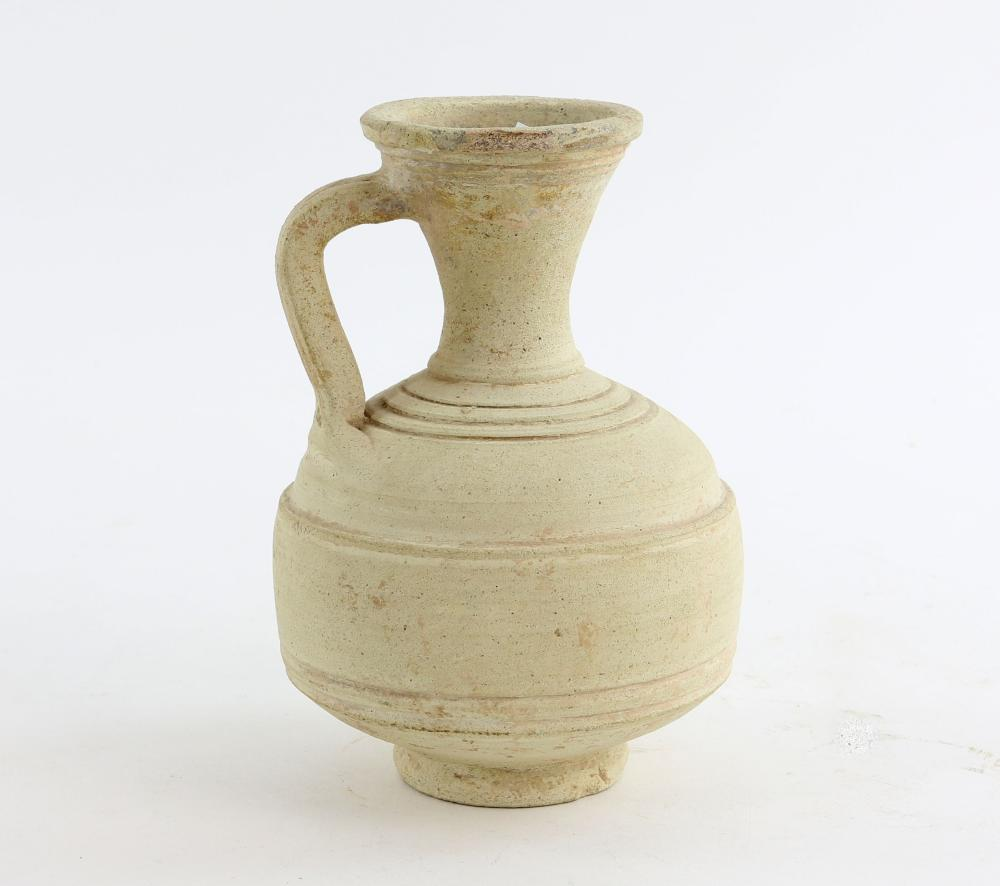 Cream pottery ewer with plain banded decoration on